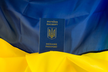 Ukrainian passport in the background Ukraine flag