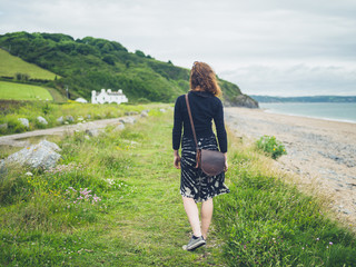 Young woman walking near the coast