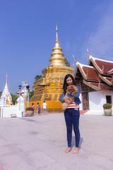 Thai woman with pomeranian at Wat Phra That Si Chom Thong Worawihan
