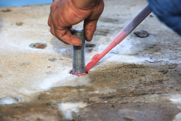 Injection adhesive chemical into hole for preparation anchor bolt