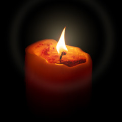 red candle in the dark