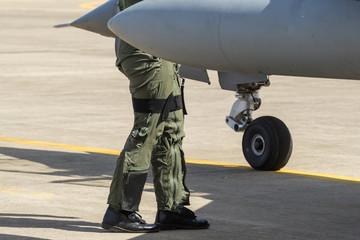 pilot and pilot suit ,the pilot walked the plane check.