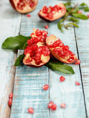 colorful pomegranate on blue wooden table