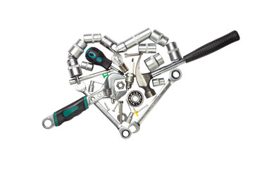 Tools arranged in a heart shape isolated on white background.