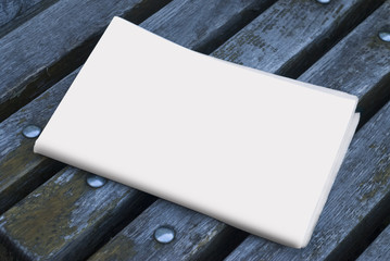 The MockUp of the newspaper on a wood background