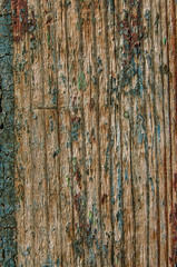 old wooden boards with paint peeling close-up