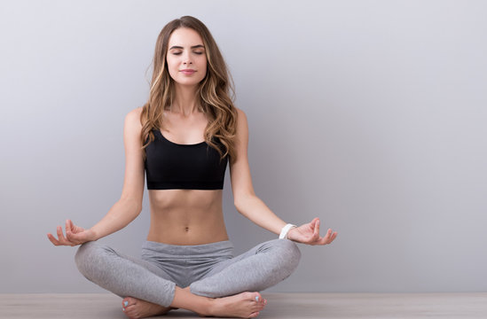 Relaxed young woman practicing yoga