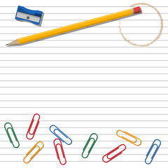 Office supplies on lined background.