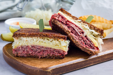 Classic reuben sandwich, served with dill pickle, potato chips, horizontal