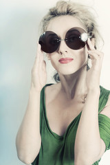 Portrait of young beautiful woman in the round sunglasses