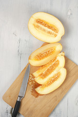 Cut melon on cutting board