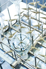Flasks and test tubes set in the tray industrial dishwasher.