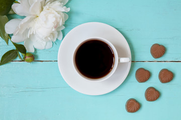White Cup with black coffee on wooden turquoise background