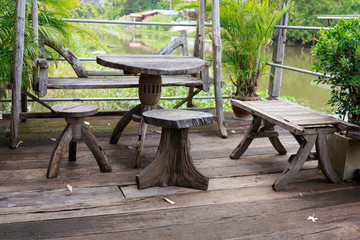 Wooden table and chairs set side the river, with freah air