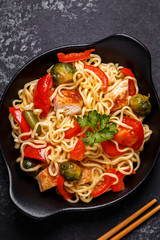 Asian noodles with vegetables and chicken.