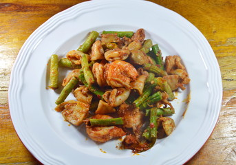 spicy stir fried mixed seafood with mushroom curry on dish