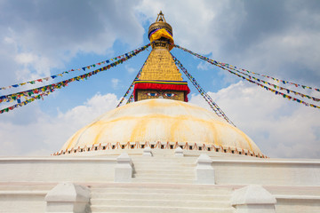 Photo of Boudhanath Stupa in the Kathmandu valley with clouds the sky Nepal. Horizontal.