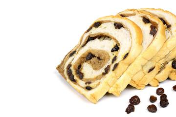 sliced raisin bread on white background
