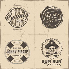 Set of vintage handcrafted pirates emblems, labels, logos. Isolated on a scratched paper background. Sketching filled style. Pirate and sea symbols - rum bottle, barrel, skull. Vector
