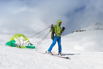 skier starts with lying paraglider