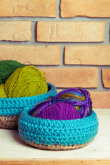 Set of blue knitted baskets