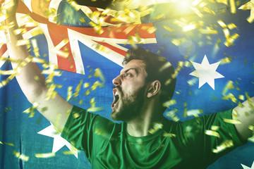 Athlete celebrating and holding the flag of Australia