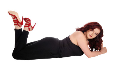Lovely woman lying on floor.
