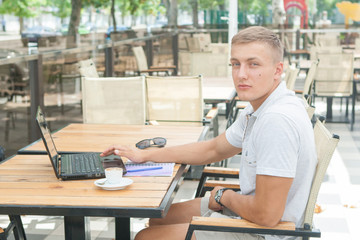 Young man sitting in cafe