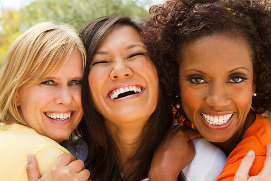 Diverse group of  best friends laughing.