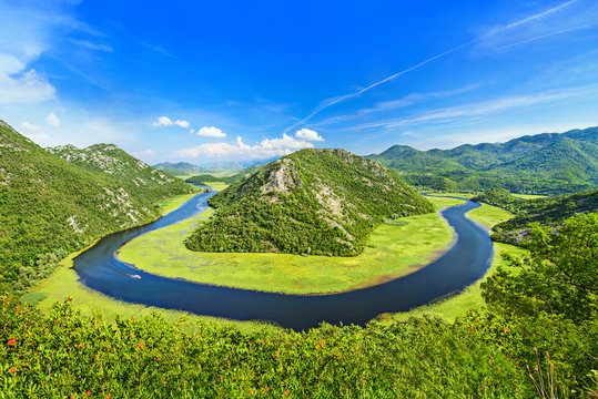 Canyon of Rijeka Crnojevica river near the Skadar lake coast. One of the most famous views of Montenegro. River makes a turn between the mountains and flows backward.