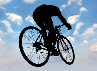 silhouette of cyclist against the blue sky