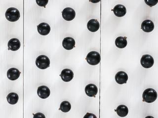 Black currant pattern wallpaper flat lay