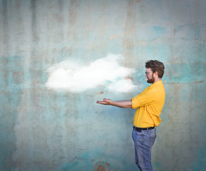 Man holding a cloud in his hands