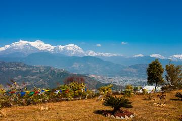 Tibetan prayer flags with view of Phewa lake and Annapurna mount