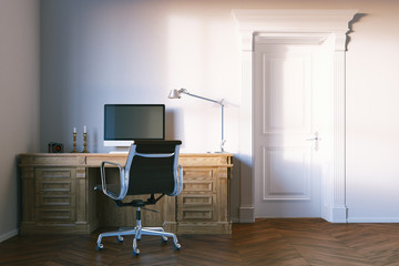 Classic elegant office cabinet with closed wooden door.