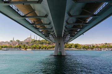 under a steel bridge in Istanbul Golden Horn