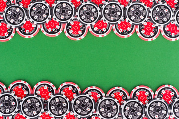 top view of green casino table with red and black chips