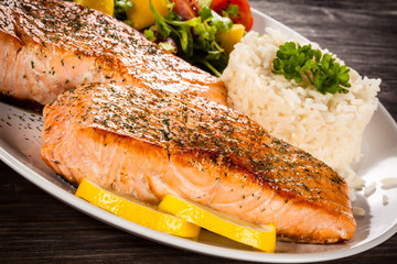 Fried salmon, boiled rice and vegetables