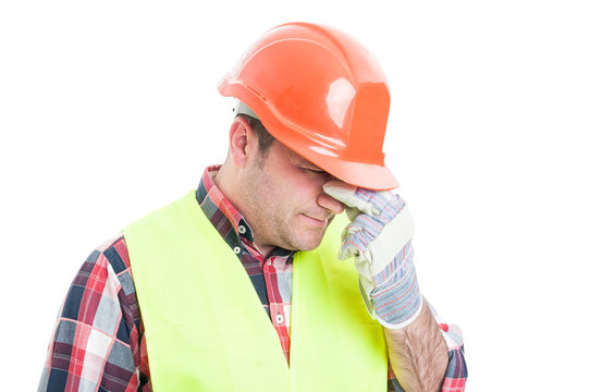 Portrait of stressed male builder looking upset