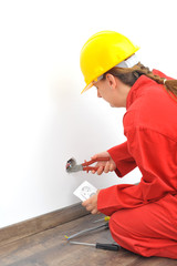 Close up of woman electrician fixing socket