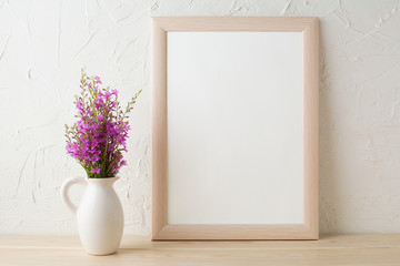 Frame mockup with purple wild flowers bouquet