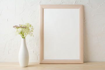 Frame mockup with tender flowers in white stylish vase