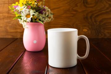 White coffee mug mockup with wild flowers