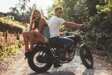 Beautiful young couple on a motorbike Wall mural