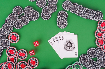 top view of green casino table with royal flush, red and black c