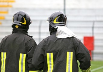 two helmeted fire brigade in the stadium