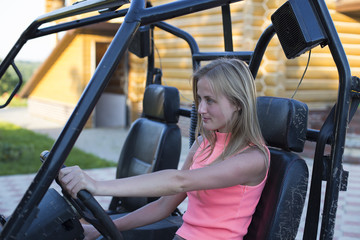 Caucasian woman driving a buggy
