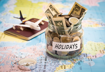 Holidays budget concept with compass, passport and aircraft toy