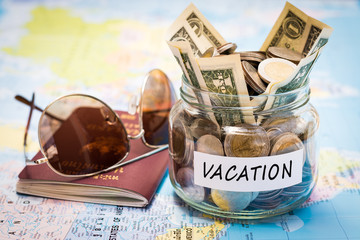 Vacation budget concept with passport and sunglasses