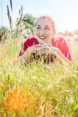 gorgeous teenage girl smiling in the grass, instagram effects